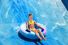 Child on water slide at aquapark Royalty Free Stock Photography