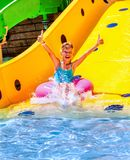 Child on water slide at aquapark Royalty Free Stock Images