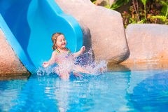 Child on water slide Stock Photography