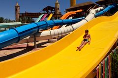 A child on a water slide royalty free stock photo