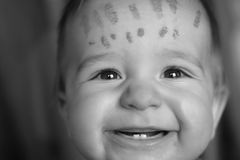 Child with watercolor on his forehead Royalty Free Stock Photos