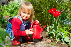 Child with watering can Stock Photography