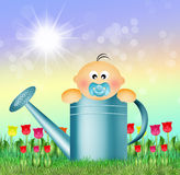 Child in watering can Stock Photo