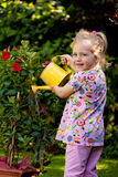 Child with Watering the flowers Royalty Free Stock Photos