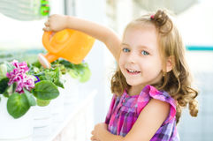 Child watering flowers Stock Photos
