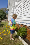 Child watering plants Royalty Free Stock Photography