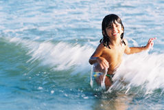 Child and waves Royalty Free Stock Images
