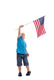 Child waving American flag. A 3 year old boy waving an American flag isolated on a white background Stock Photo