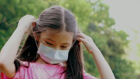 Child wear face mask during coronavirus and flu