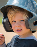 Child Wearing Baseball Helmet. Close up portrait of a young boy wearing a baseball helmet Royalty Free Stock Images