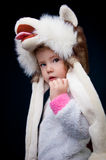 Child wearing a big dog hat Stock Photos