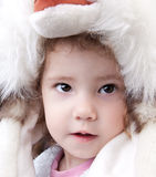 Child wearing a big hat, winter Stock Image