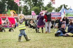 Child wearing ear defenders at festival Royalty Free Stock Photography