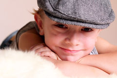 Child wearing Flat Cap. A smiling young boy child wearing flat cap. Shallow depth of field focus on face small little Stock Photography