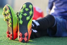 Child wearing football boots