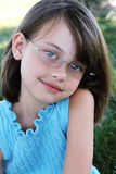 Child Wearing Glasses. Little girl wearing glasses and looking directly at viewer. Shallow depth of field with selective focus on child's face royalty free stock images