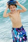 Child wearing goggle and swimming trunks Royalty Free Stock Photo