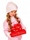 Child wearing in hat and mittens holding red  gift Royalty Free Stock Photos