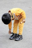 The child. Child is wearing her shoes Stock Image