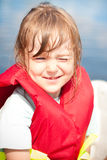 Child wearing lifejackets. Close up stock photos