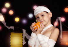 Child wearing mummy costume Stock Photography