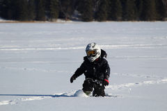 Child Wearing an OHV Stepping Through Deep Snow Royalty Free Stock Photo
