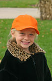 Child Wearing Orange Hat Stock Photo
