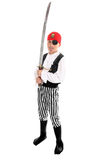 Child wearing a pirate costume. Full length boy wearing a pirate costume and holding a long sword. eg halloween, play, costume party, theatre stock image