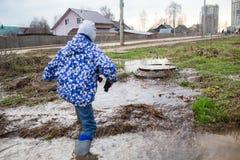 Child wearing rain boots Royalty Free Stock Photos