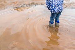 Child wearing rain boots Stock Photography