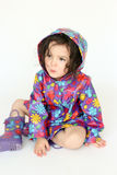 Child wearing rain coat and boots. Adorable child wearing a rain coat and matching boots Stock Images