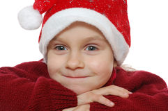 Child wearing red Santa�s hubcap. Royalty Free Stock Photos