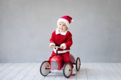 Baby having fun at Christmas time Royalty Free Stock Image