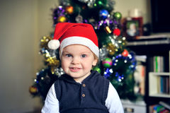 A child wearing Santa Claus hat Stock Photos