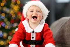 Child wearing santa disguise in christmas royalty free stock photos