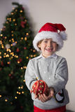 Child wearing a santa hat Stock Photos