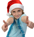 Child wearing a Santa hat with thumbs up Royalty Free Stock Photos