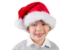 Child wearing a santa hat. On white background Royalty Free Stock Photo