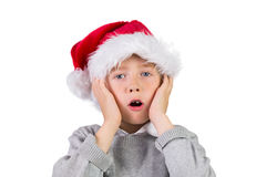 Child wearing a santa hat. On white background Royalty Free Stock Image
