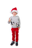 Child wearing a santa hat Royalty Free Stock Photography