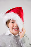 Child wearing a santa hat Royalty Free Stock Images