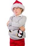 Child wearing a santa hat Stock Photo