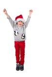 Child wearing a santa hat Stock Image
