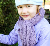 A child wearing a scarf Stock Images