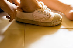 Child wearing shoe in his house.Zoom in. royalty free stock photography
