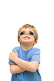 Child wearing sunglasses. Four year old child wearing sunglasses to protect his eyes Stock Image