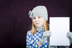 Child wearing winter clothing Stock Photography