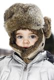 Child wearing winter hat Stock Photography