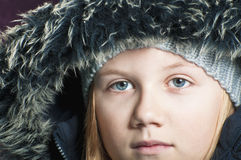 Child wearing a winter hat Royalty Free Stock Photos