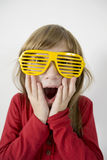 Child wears yellow glasses Royalty Free Stock Image
